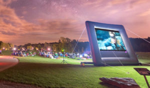 Families Watching Movie in the Park