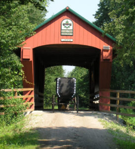 Amish Buggy Under Covered Bridge on Maple Highlands Trail